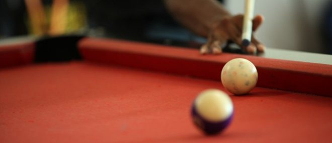 Closeup View Of Student Playing Pool