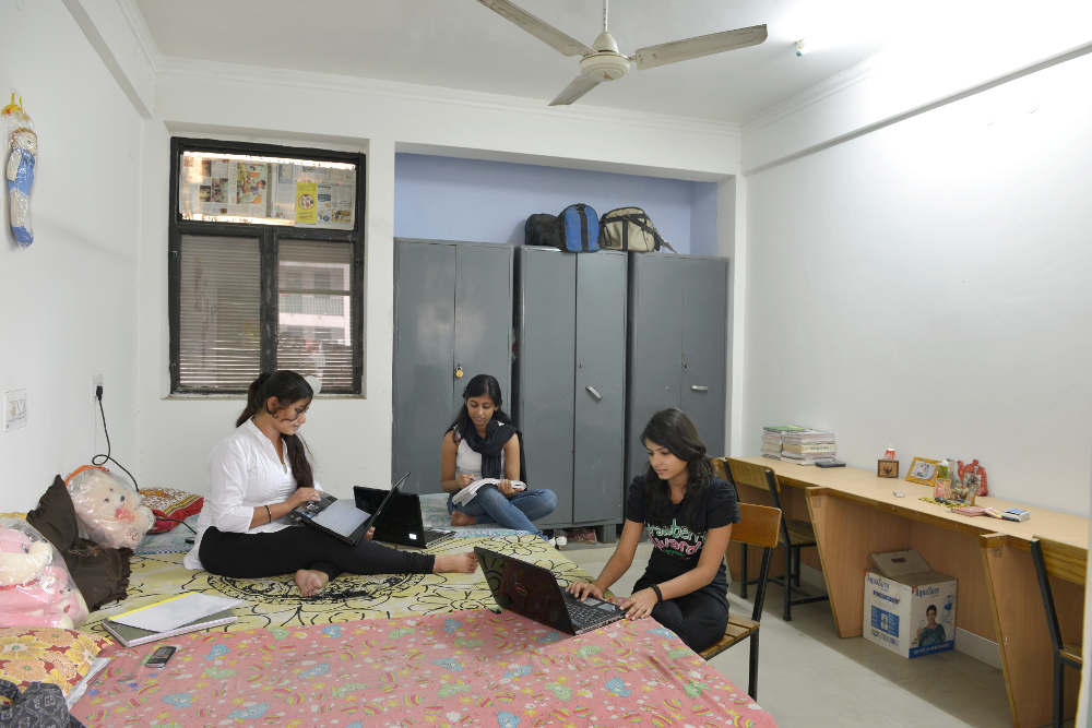 Students Studying Inside The Hostel Room