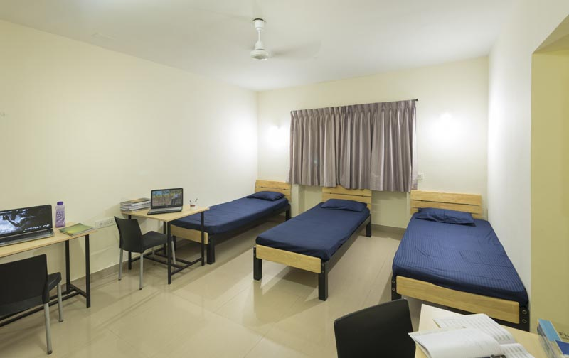 Hostel Room With Beds And Study Table