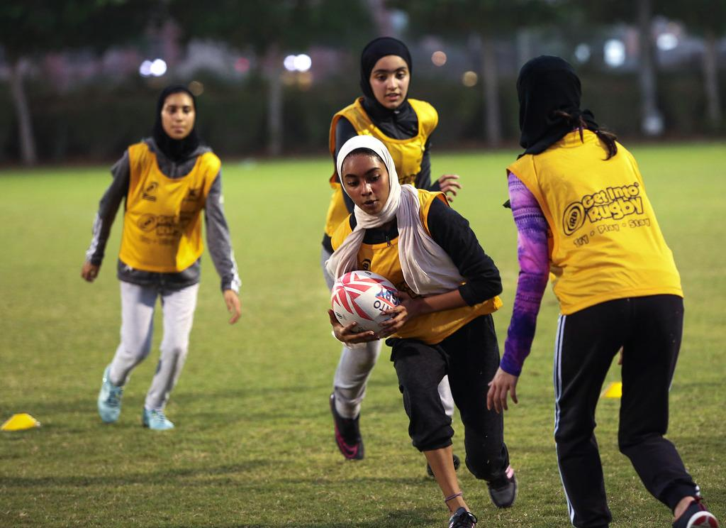 Female Students Playing Football